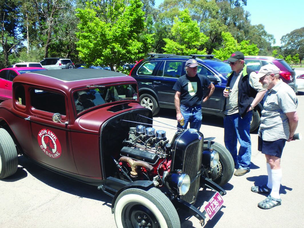 Two Daves admire our Club Captain's new hot rod at the BBQ